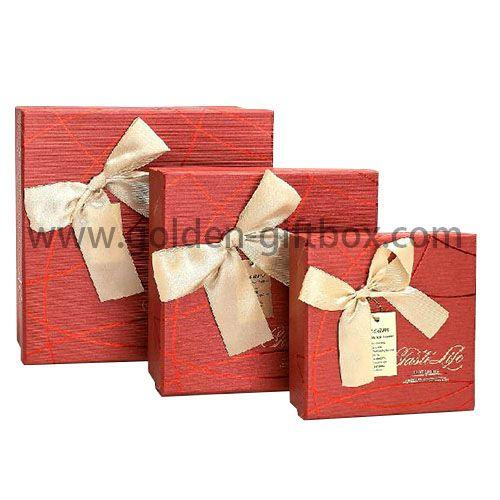 Classic red paper gift box with ribbon