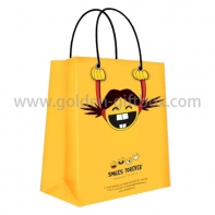 Yellow shopping bag with funny pattern design and 2 handles