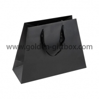 Trapezoid shopping bag with matt lamination and ribbon handles