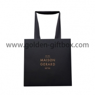 Black ground gold wordings shopping bag with long ribbon handles
