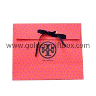 Red & silver pattern paper bag with ribbon bow for closure