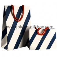 Shopping bag with blue stripes and red handles