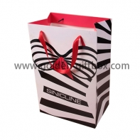 Ladies' wear shopping bag with black pattern and pink ribbon handles