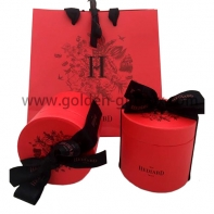 Elegant red colour shopping bag with black ribbon bow & handles