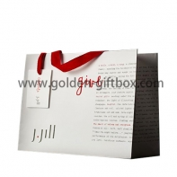 White shopping bag for ladies with red tape handls