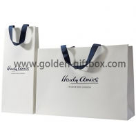 Elegant shopping bag with matt lamination and blue handles