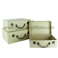 Elegant paper suitcase with metal decorative parts and handle