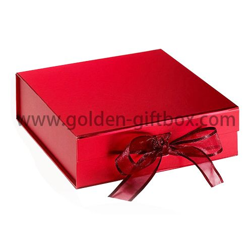 Red colour foldable box with grosgrain bow for gifts and dresses and shirts